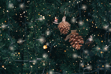 Wall Mural - Vintage Christmas tree with pine cone decoration and sparkle light filter effect. Christmas and New Year holiday background. vintage color tone.