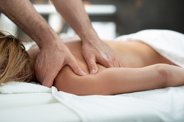I feel relaxed. Close up of therapist hands treating middle aged woman with spa procedure