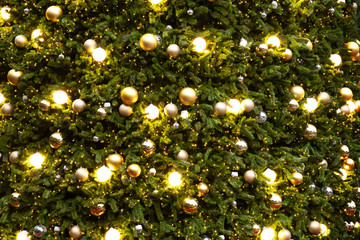 Wall Mural - Vintage Christmas tree with gold ball ornament and sparkle light. Christmas and New Year holiday background.