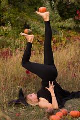 Girl in Halloween costume practicing yoga