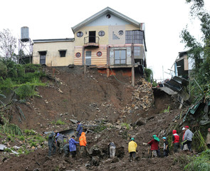 Rescuers search for three residents buried in a landslide at the height of Typhoon Mangkhut that hit Baguio