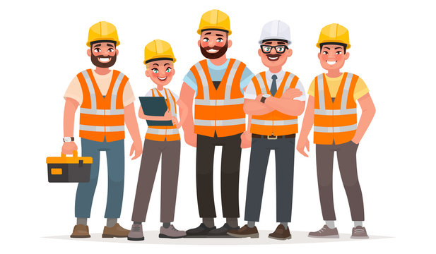 Builders dressed in protective vests and helmets. Workers at the construction site