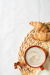 Cup of coffe and pastry on white background