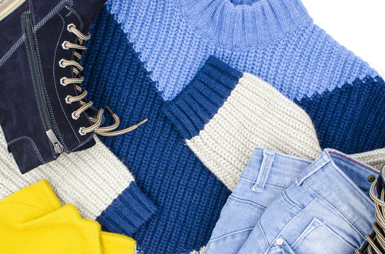 Different colored warm clothes are on a white background