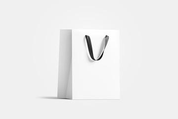 Blank white paper gift bag with black silk handle mockup, isolated, 3d rendering. Blank plastic packet mock up, side view. Beautiful package template. Craft bagful for present