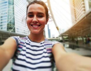 Beautiful woman take photo selfie traveling in Bangkok, Thailand.