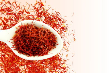 saffron in spoon on white background for food and flavor extract concept,flat lay