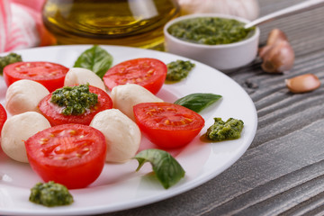 Caprese salad on a wooden rustic background