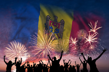 People are looking on fireworks and flag of Moldova
