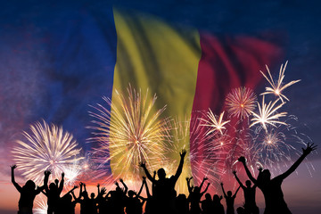 People are looking on fireworks and flag of Romania