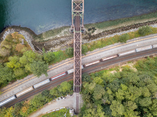 Crossing graphic rusty railway bridge structure aerial view from above