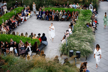 Models present creations at the Roland Mouret catwalk show at the National Theatre at London Fashion Week Women's in London