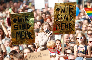 People attend a protest march against right-wing extremism in Cologne