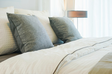 Closeup gray pillows on bed in classic style interior bedroom