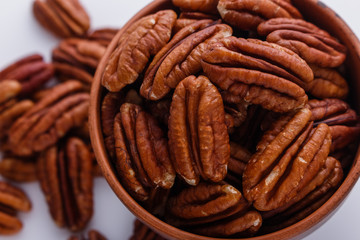 delicious pecan nuts on a white acrylic background
