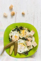 fried eggs with chard and marinated cornichons