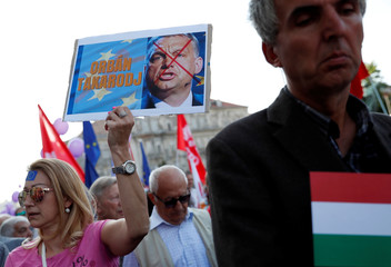 People attend a demonstration against Hungary's Prime Minister Viktor Orban in Budapest