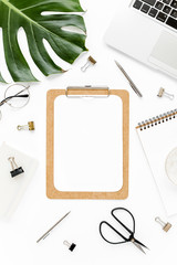 Mockup with clipboard, laptop, palm leaf, clips. Flat lay, top view