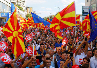People hold placards reading ÔYes for European MacedoniaÕ during a march in support of a referendum in Skpoje