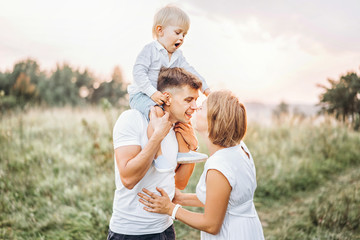 Young family with little son have fun outdoor