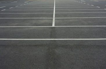 Car parking lot with white lines mark. White markings on asphalt in empty parking lot.