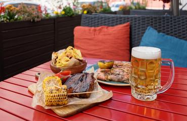 Beer and savory food on table