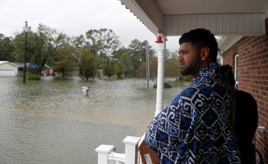 Keneen Allen watches floodwater rise from his grandmother's porch during Tropical Storm Florence in Lumberton