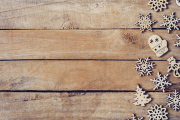 Wooden brown christmas background with snowflakes and christmas decoration.