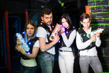 Young people in laser tag labyrinth