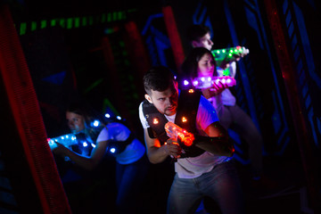 Emotional guy playing laser tag