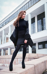 Street (city) fashion: portrait of beautiful young girl in black