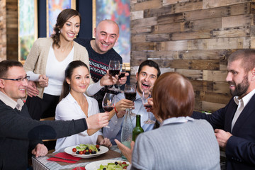 Company men and women in the restaurant