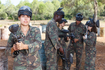 Female paintball player ready for game