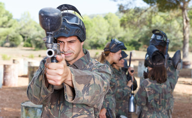 Male paintball player ready for game