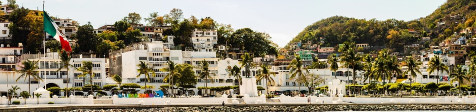 The port of Manzanillo, Mexico. Large panoramic view of the downtown area, shot from the harbor.