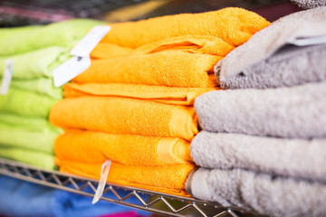 different colour towels in shop