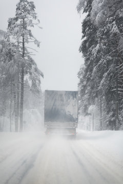 Truck drives through cold weather conditions