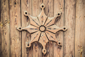 Carved wood pattern on the gate