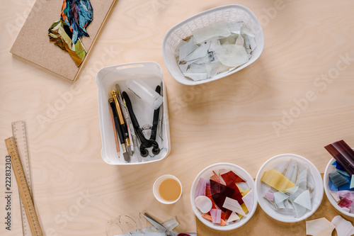 Workplace of mosaic maker: material and tools on wooden table