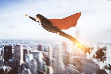 Creative super hero businesswoman
