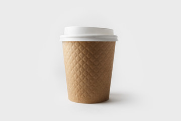 Blank kraft paper coffee cup with cap. Disposable cup.