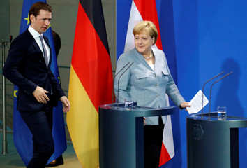 German Chancellor Angela Merkel and Austrian Chancellor Sebastian Kurz arrive to give a statment to the media in the chancellery in Berlin