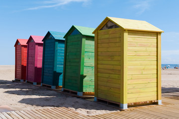 Wooden changing rooms on the beach