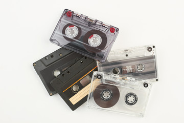 Pile of retro cassette tapes. Stack of old tape cassetes over white background. Music vintage device.