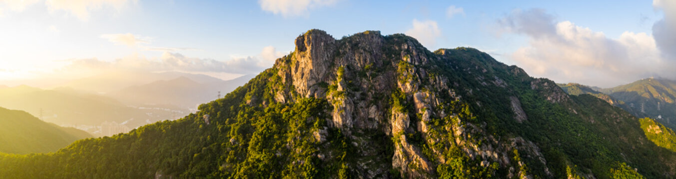 Panoramic of Lion Rock mountain under sunset