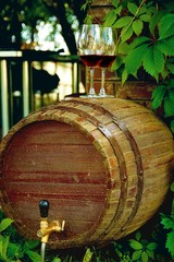 Wooden barrel of wine on the street near the vineyard