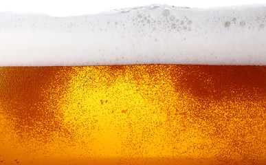 Close up background of beer with bubbles in glass