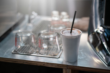 iced coffee in the white cup at the cafe shop.