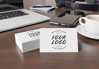 Stack of Business Cards on Wooden Desk Mockup