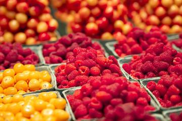 Closeup of a cardboard full of fresh organic fruits at a pubic market